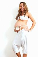 Pregnant woman with gift ribbon on belly