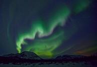 Aurora borealis or northern lights above the mountains outside of Whitehorse, Yukon Territory, Canada.