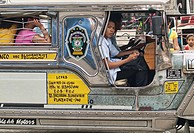 One jeepney driver looking at the camera, Manila, Philippines