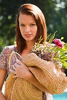 Young woman holding bouquet