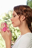 Young woman holding orchid (thumbnail)