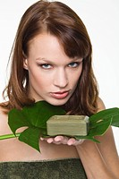 Young woman holding olive oil soap