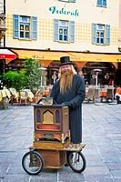 Ballad singer, Piazza della Riforma, Lugano, Switzerland