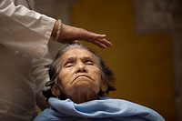 A woman receives Reiki in Mexico City, November 30, 2010  Reiki is a spiritual practice developed in 1922 by Japanese Buddhist Mikao Usui  It uses a t...