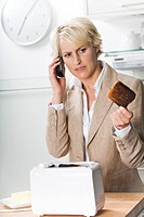 Businesswoman with burnt toast in the morning