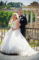 Portrait of bride and groom in front of Fori Imperiali in Rome, Italy