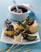 Fresh fruit Fondue with melted milk chocolate and crushed dried fruit and nuts