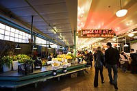 Pike Place Market, Seattle, Washington - Couple walking by the flower stalls