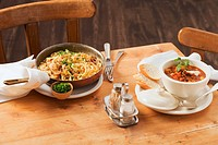 Cheese spätzle soft egg noodles from Swabia with fried onions and goulash soup