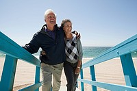 Mature couple on beach walkway