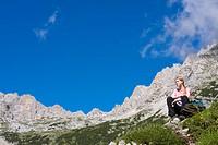 Hiker resting near the Gruppo del Sorapiss, Dolomites, Alto Adige, South Tirol, Alps, Italy, Europe