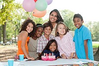 Children at birthday party with birthday cake
