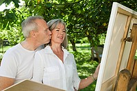 Mature couple, woman painting at easel (thumbnail)