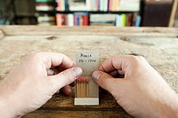 Person holding matchbook with phone number written on it (thumbnail)