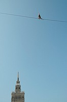 Polish slackliner Damian Czermak during show in Warsaw, Poland  Palace of Culture and Science building on background