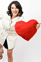 Woman holding a heart_shaped cushion