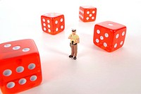 Policeman miniature between cubes, symbolic image illegal gambling