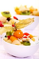 Fruit salad made of various fruits with yogurt