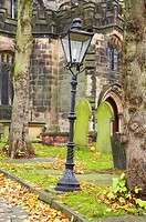 Victorian lamp post in Church grave yard in Sandbach, Cheshire, UK