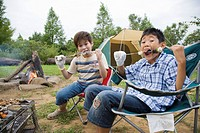 Boys eating at barbecue, Chiba Prefecture, Honshu, Japan