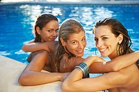 Girls relaxing in swimming pool