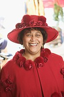 Portrait of a senior woman wearing a fancy red hat.