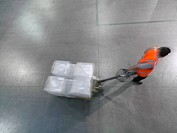 Worker pulls pallet truck