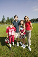 Football player and cheerleader with parents