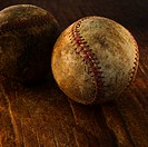 Antique baseballs on wooden floor