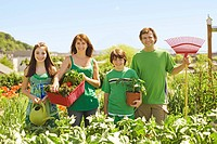 Family in in vegetable garden