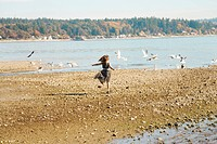 Girl running on beach in party dress