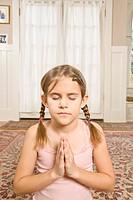 Girl praying with eyes closed