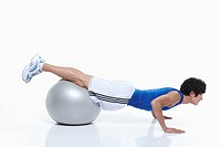 guy stretching on gym ball