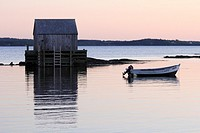 a wharf fish shack and boat in a fishing village near Lunenburg Nova Scotia