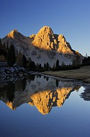Small lake with the mountain Eisengabel / Furcia dai Fers and reflection at the Fanes area in autumn at sunset  Nature Park Fanes-Sennes-Braies, Fanes...