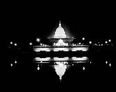 USA, Washington DC, US Capitol at night reflecting in Tidal Basin.