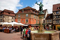 Fountain in front of old half-timbered houses, square in Colmar, Alsace, France, Europe
