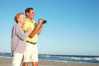 Couple with binoculars on the beach, Far Rockaway, Queens, New York City, New York State, USA