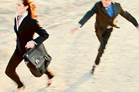 Businessman chasing a businesswoman