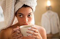 Mixed race woman drinking coffee in the morning