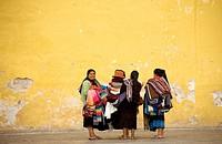Street vendors look for customers in San Cristobal de las Casas, Chiapas, Mexico, March 1, 2010
