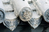 Butterfly dragon head roof tile motif in Xingguo Monastery on Thousand Buddha Mountain, Qianfo Shan, Jinan city, Shandong, China