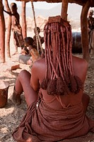 Namibia, Opuwo. The back view of a Himba woman showing her hair covered with ochre and mud. Credit: Wendy Kaveney / Jaynes Gallery / DanitaDelimont.co...