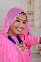 Indian woman wearing traditional sari at The Jaswant Thada, a Jodhpur architectural landmark. The monument is built entirely out of intricately carved...