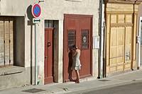 France, Sault. A girl peeks through a garage window. Credit: Josh Anon / Jaynes Gallery / DanitaDelimont.com