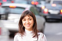 Smiling brunette and traffic