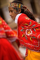 Ecuador, Cuenca. Girl dancer in folklore troupe during annual parade and festival to celebrate founding of Cuenca in 1557. Cuenca is a UNESCO World He...