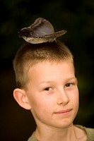 Ecuador, Mindo. Mindo Butterfly Farm. Boy age 9 with Caligos butterfly on his head. MR