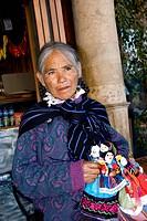 Mexico, San Miguel de Allende, Mexican Woman selling dolls in street. Credit: Nancy Rotenberg / Jaynes Gallery / DanitaDelimont.com