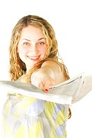Woman passing newspaper